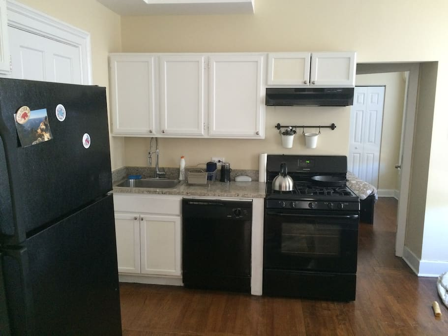 Kitchen has all the necessary amenities: Full size refrigerator, oven, dishwasher, tea/coffee maker, etc...