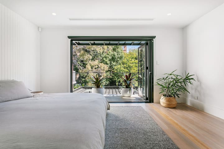 Master bedroom with super king bed, ensuite with shower, and leafy views from the stackable bi-fold glass doors. There is a fly screen to cover the entire door which rolls out of the door frame.