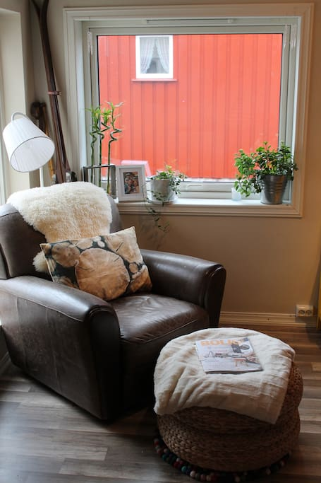 Cozy chair in living room / dining room.