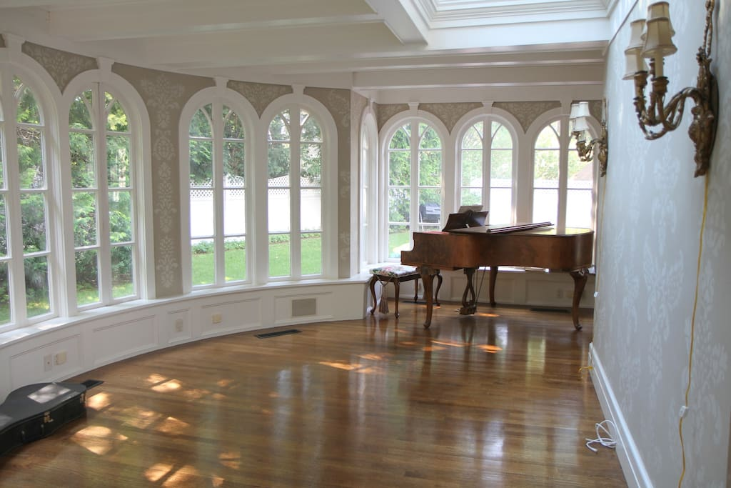 Beautiful sunroom with tuned, working baby grand piano and guitar