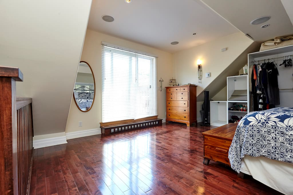 Sliding glass door overlooks backyard, large dressing mirror....a quiet oasis in the city.