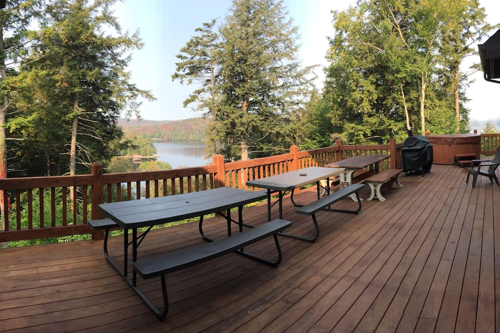 Deck overlooking Tupper Lake with charcoal grill,  Hot tub seats 6