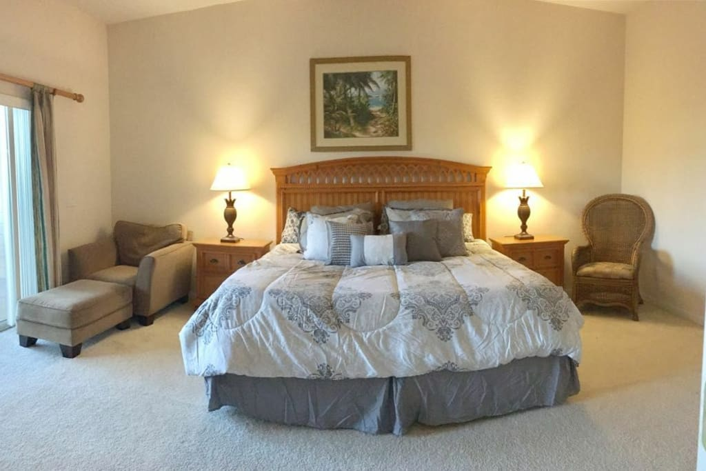 Master bedroom with own full bathroom and queen bed and walk in closet