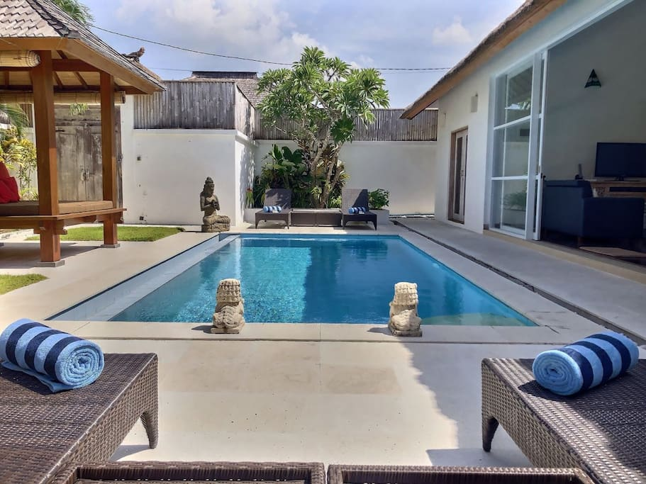 Spend time relaxing by the private pool