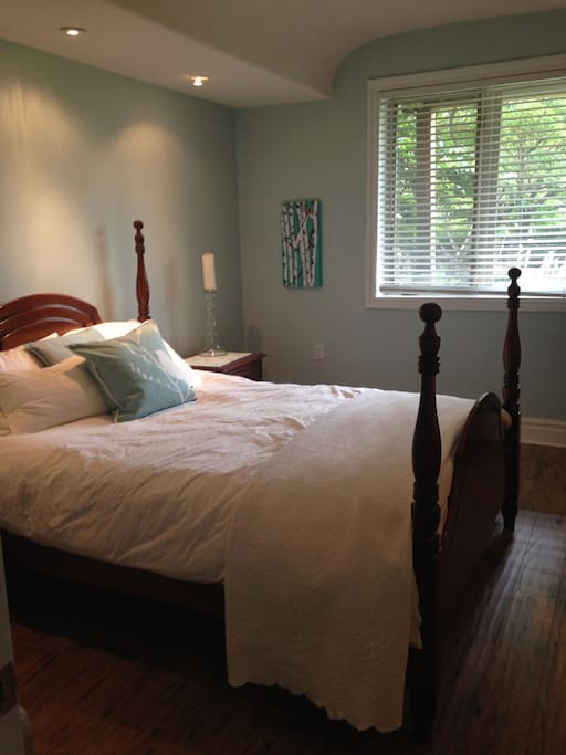 Queen Size bedroom with view to green space