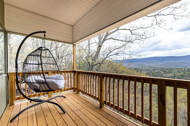 Private King Room deck includes a hanging chair and seating area for 2.