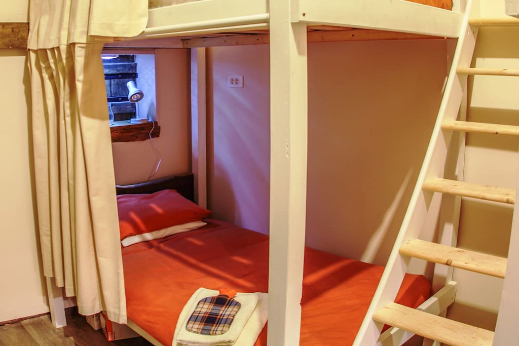 Our private cabin beds in Le Dortoire