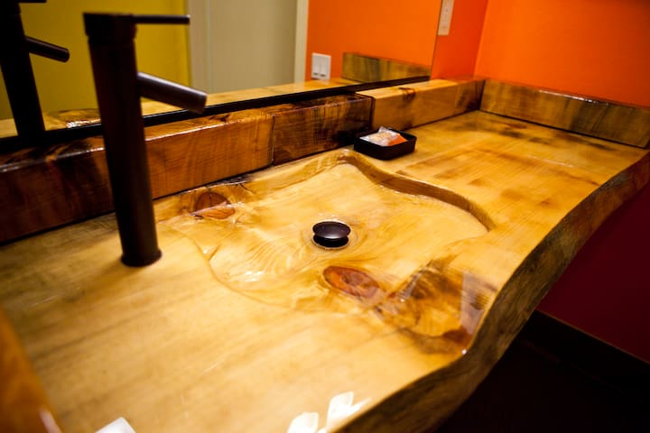 Live edge wood slab sink and counter top.