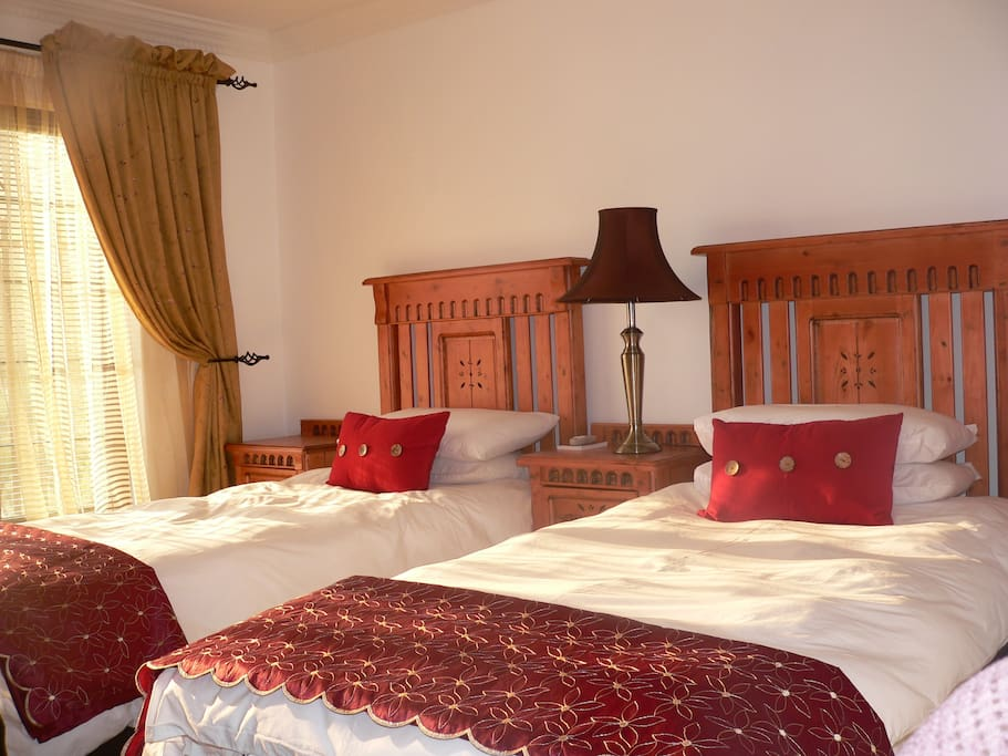 Rooms have a crisp clean, welcome feeling with Aircon, Dstv, Honesty bar and ameneties