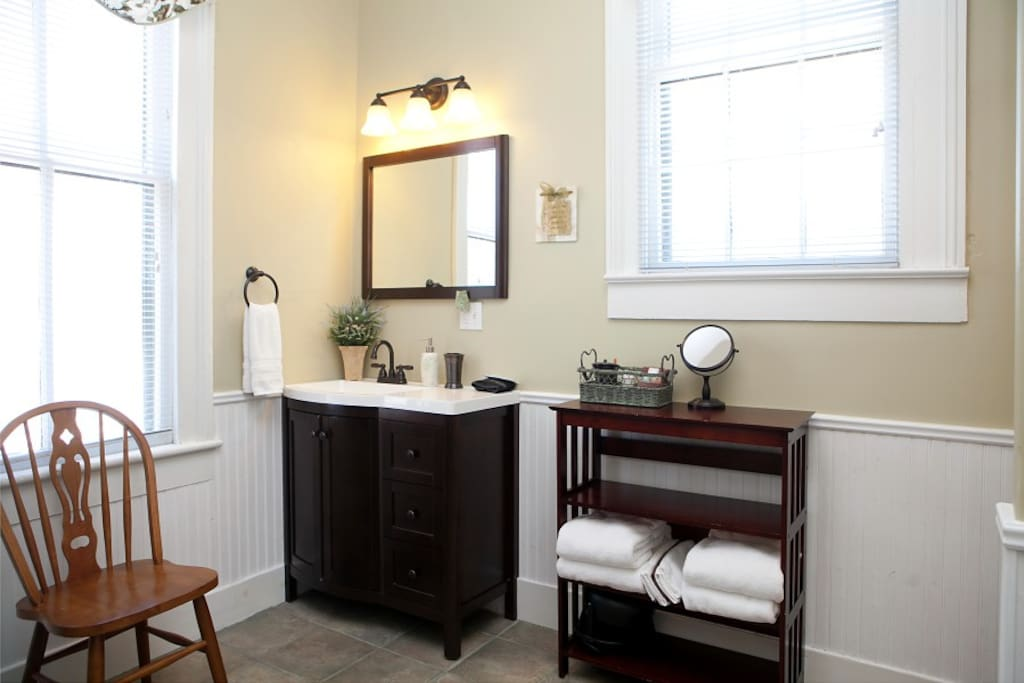 Large bathroom with lots of light.  Shower only, no bathtub.