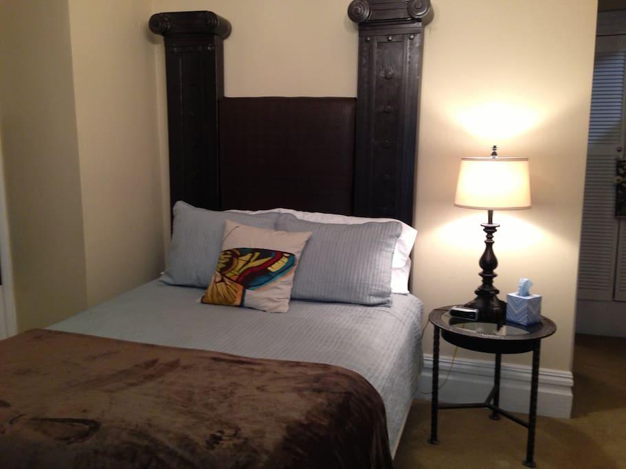 Cozy bedroom space offers super comfy queen bed.
