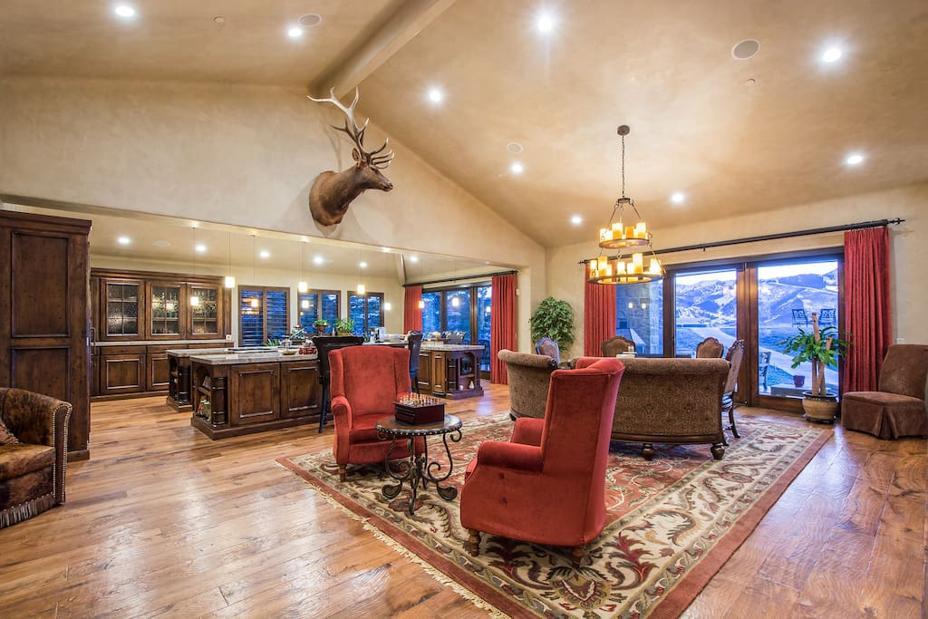 The living room and kitchen. Enjoy a stunning view of the mountains. The home faces the west so you don't want to miss the sunset.