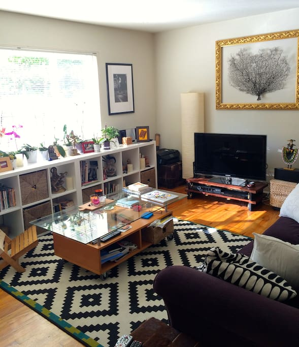 Sunny living area with wifi and cable, available for use.