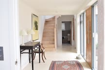 Spacious hallway with stairs to twin bedroom