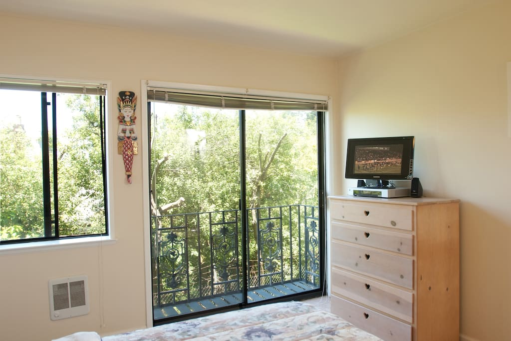 Sunny bedroom, with birch dresser & Xfinity TV