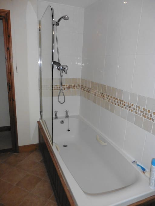 Own bathroom with bath and shower in one
