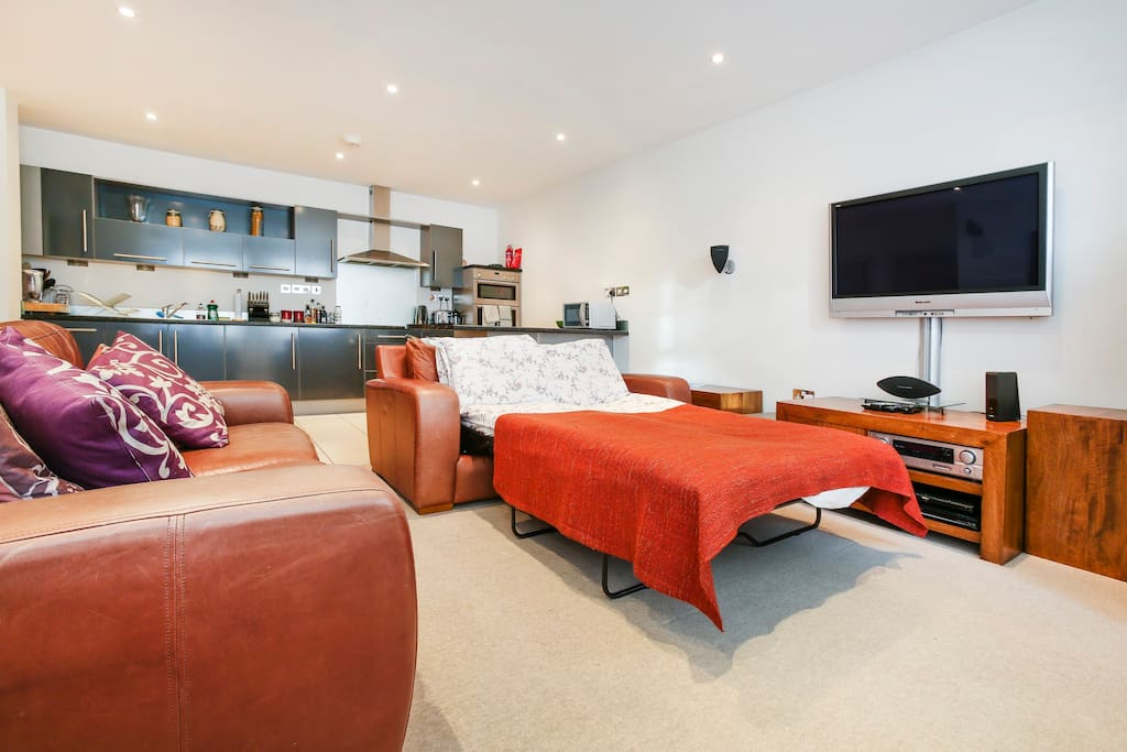 Bright, open-plan living space with optional sofa bed extended