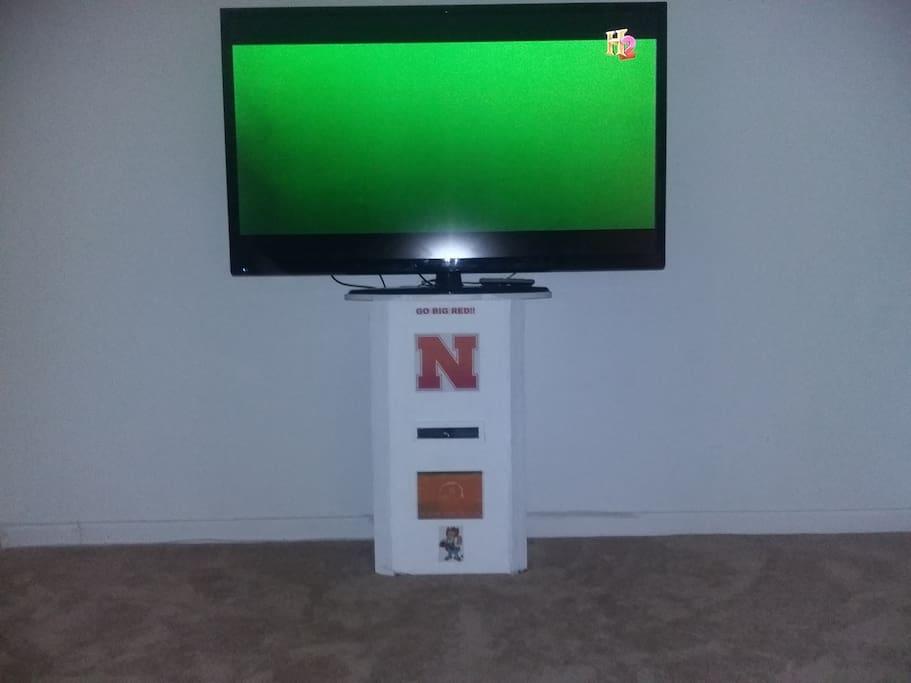 60 inch TV in 2nd bedroom/game room. I am a Nebraska fan. GO BIG RED!!