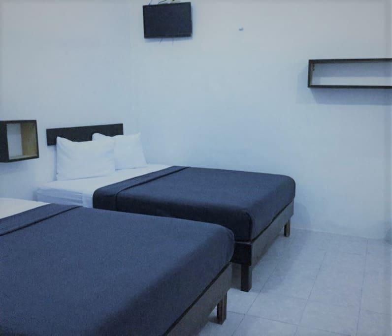 Habitación Doble baño, aire acondicionado, televisión incluidos