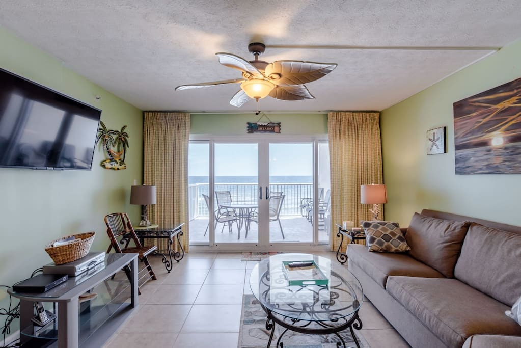 Flat Screen TV and Balcony Access from Living Area