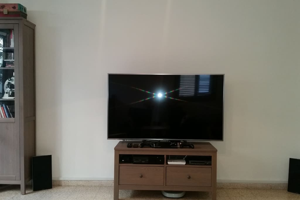 60in Panasonic smart TV connected to the PC for work or movies, and an Xbox one with really strong Skype capabilities and   100 MB internet with a router for WiFi