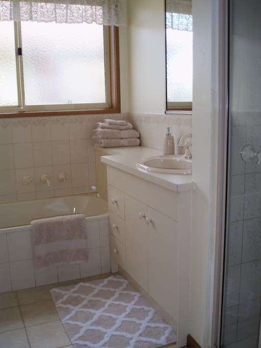 Spacious bathroom, with bath, shower and lots of storage