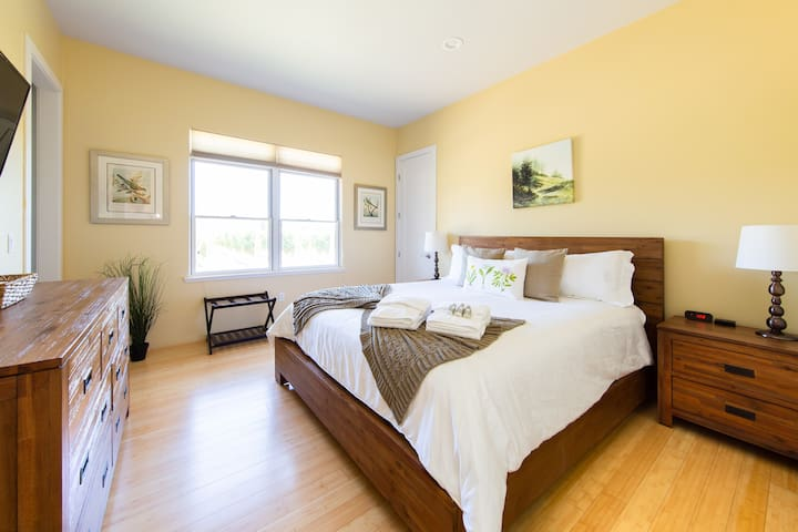 Bedroom #2 features a King-Size Bed, TV, Private Bathroom, and Views of the Vineyard