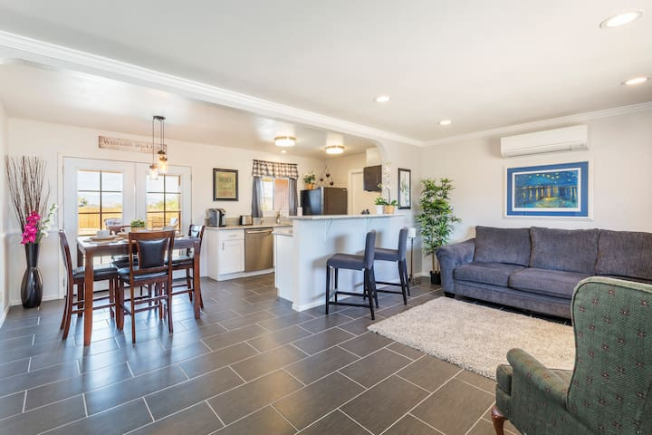 Your living room is spacious with a breakfast bar and an open floor plan.