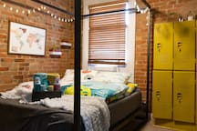The guest room is well-appointed for comfort with an insanely comfortable 10-inch thick memory foam mattress. Funky vintage lockers can be used for storage, with hanging live planters and fairy bottle string lights to add a touch of magic.