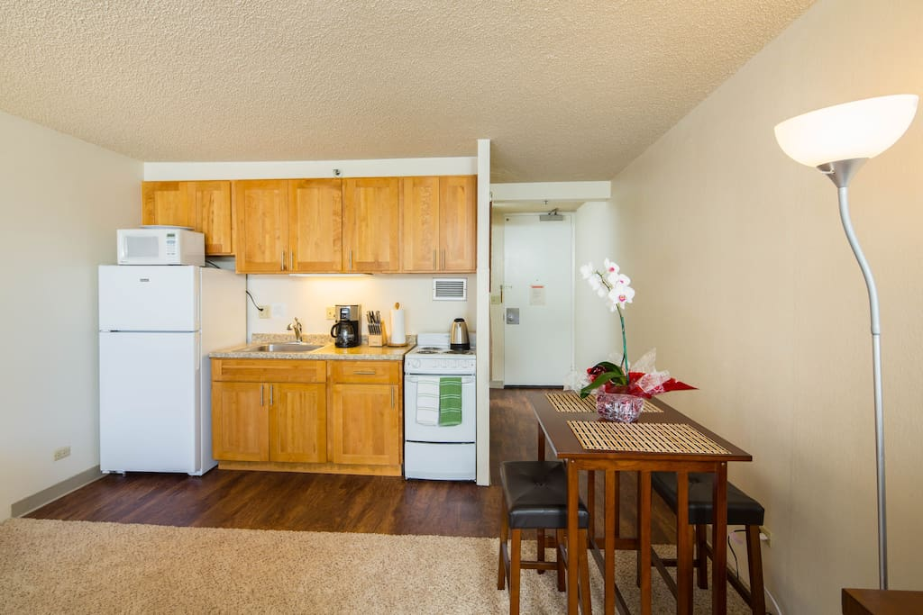 Great dining table and a recently renovated kitchen!