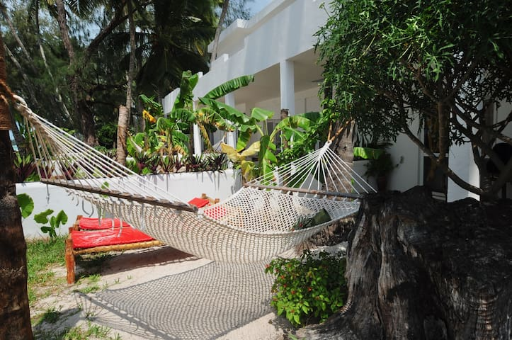 Private garden with hammock and sunbeds