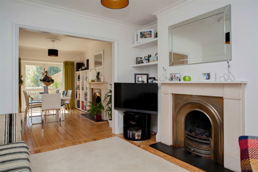 Lounge/diner/playroom with gas fire and digital TV, doors open to garden