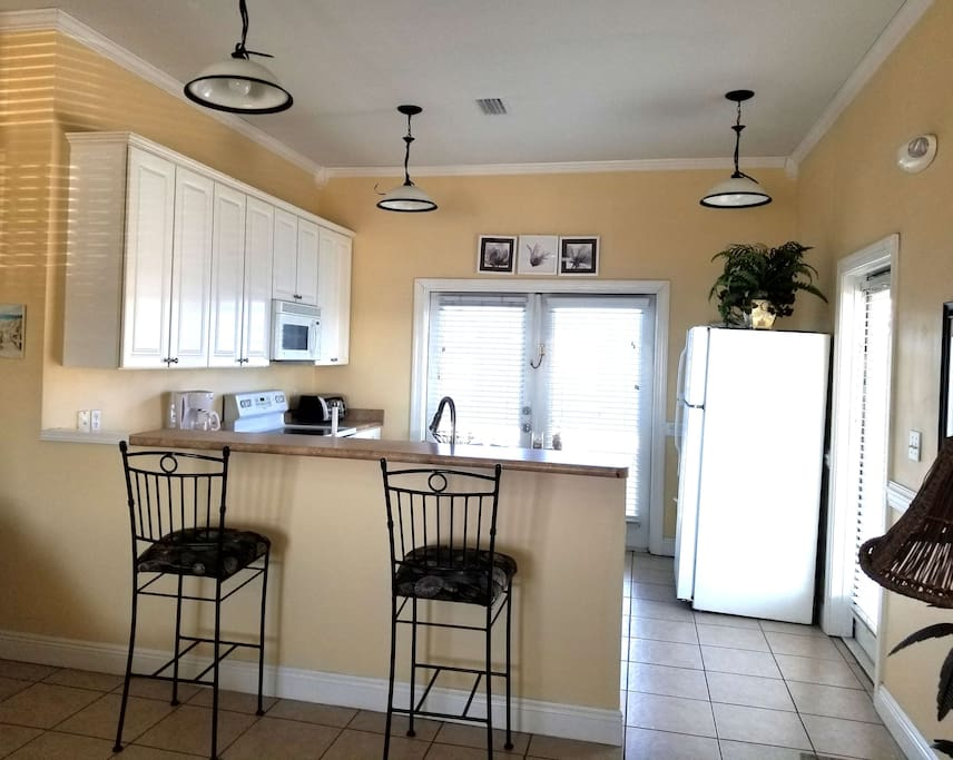 Fully equipped kitchen, open to the living area.