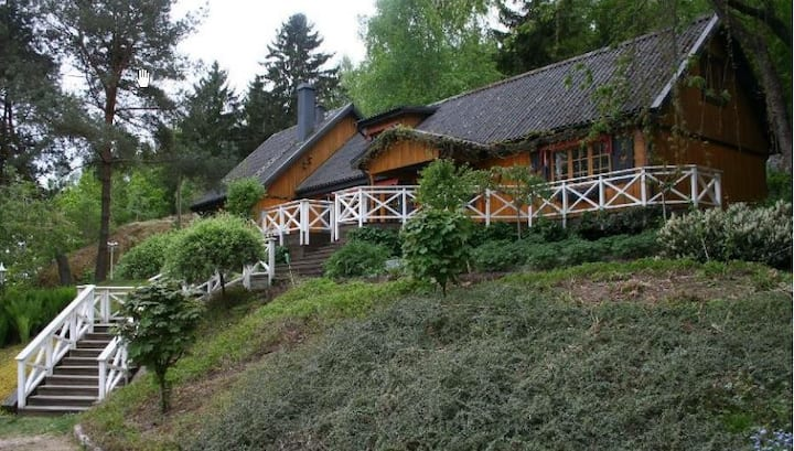 Romantic wooden guesthouse by the forest