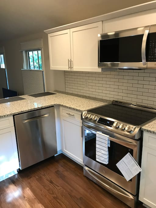 Brand New Kitchen with High-end Appliances, Utensils, Cookware and Dishes.  Kitchen is complete with stove, oven, microwave, dishwasher, and full size refrigerator with filtered water inside the door (and ice in freezer).