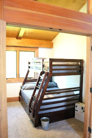 Single over double bunk in laundry/storage room