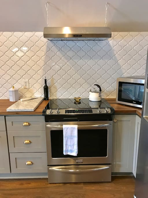 Full size electric cook top/stove and counter-top microwave.