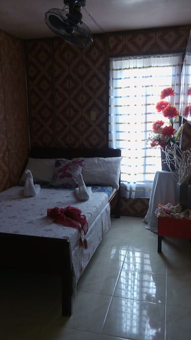 the bungalow room in mdf beach resort with electric fan