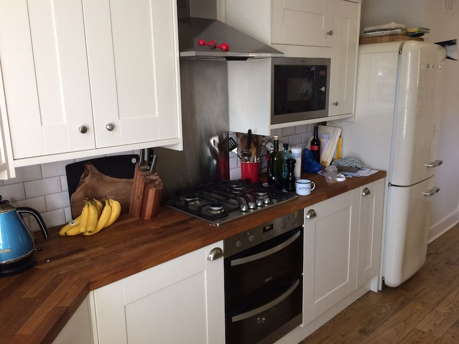 Double oven, built in AEG microwave (both 1 year old) and SMEG fridge, all for you to enjoy!