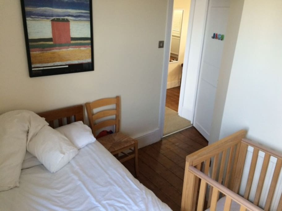 Comfortable double bedroom with built in cupboards (cot can be removed if not needed)