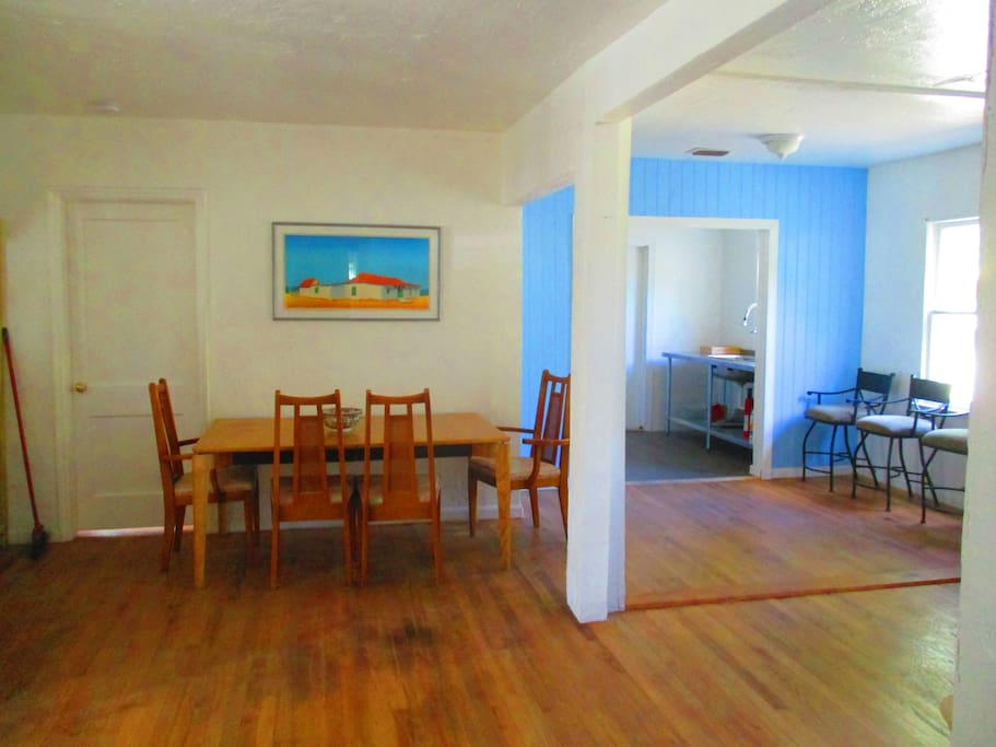 Here is the shared living room enjoy some coffee and Wifi along with original hardwood Dade Pine floors