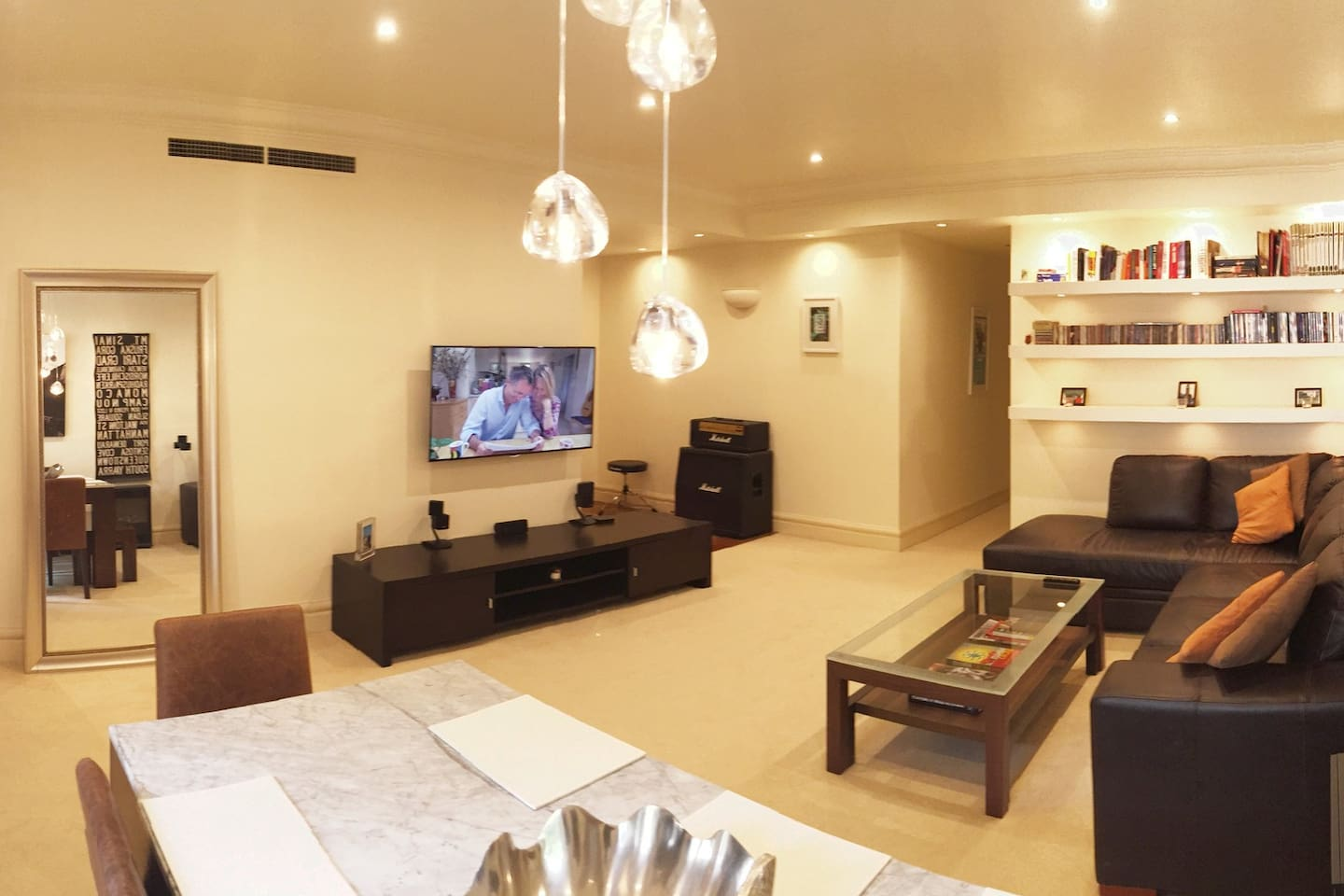 This spacious and luxurious apartment is equipped with a comfortable large internal living space with a large corner sofa, large marble dining table and large LCD Smart TV.