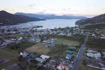This drone photo shows the studio in the bottom left, where the vivid blue car is parked, and how close we are to the Waikawa Marina & the Bay leading out to Queen Charlotte Sound, (part of the Marlborough Sounds). We have hill views out two sides.