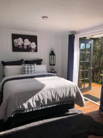 Bedroom with french doors onto the deck