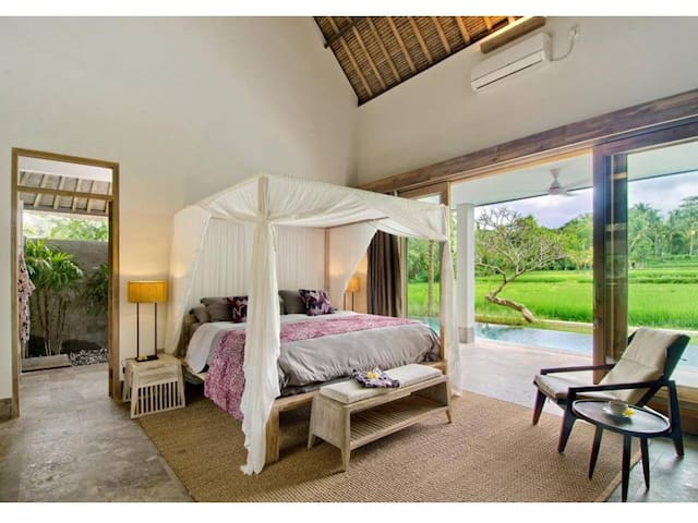 master bed room with open view to rice field