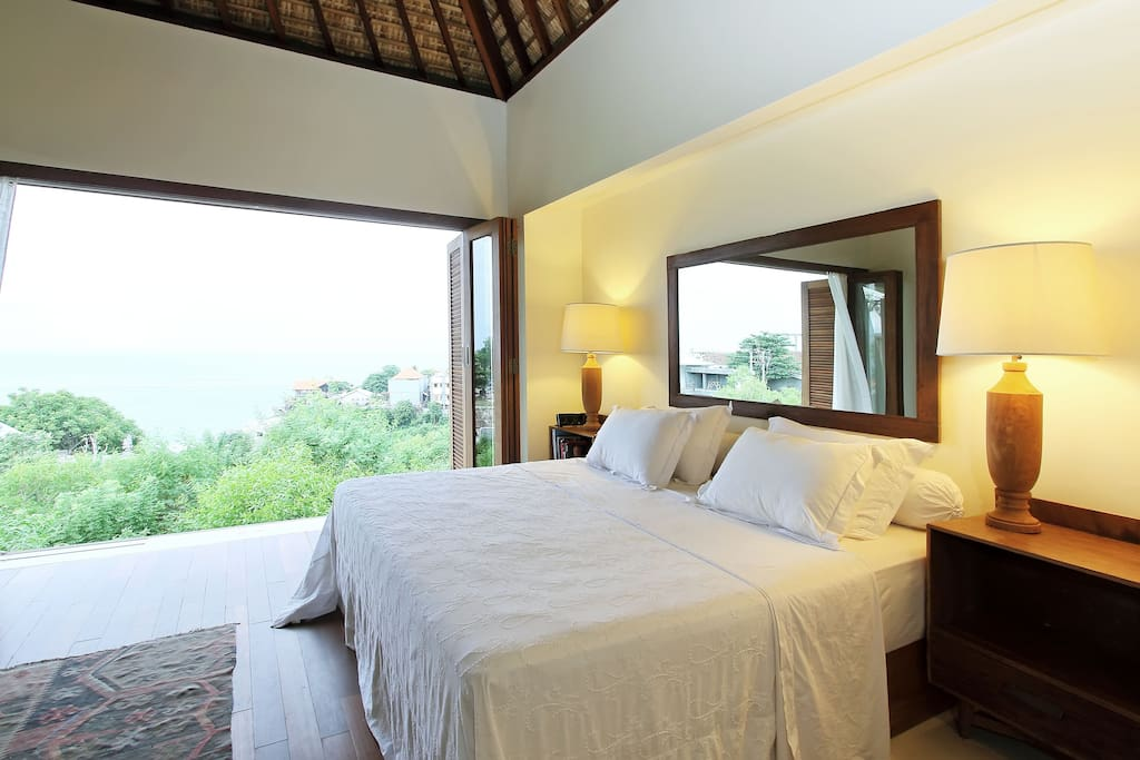master bedroom with view to ocean and the waves in uluwatu.