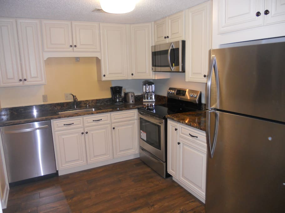 A brand new granite and stainless kitchen