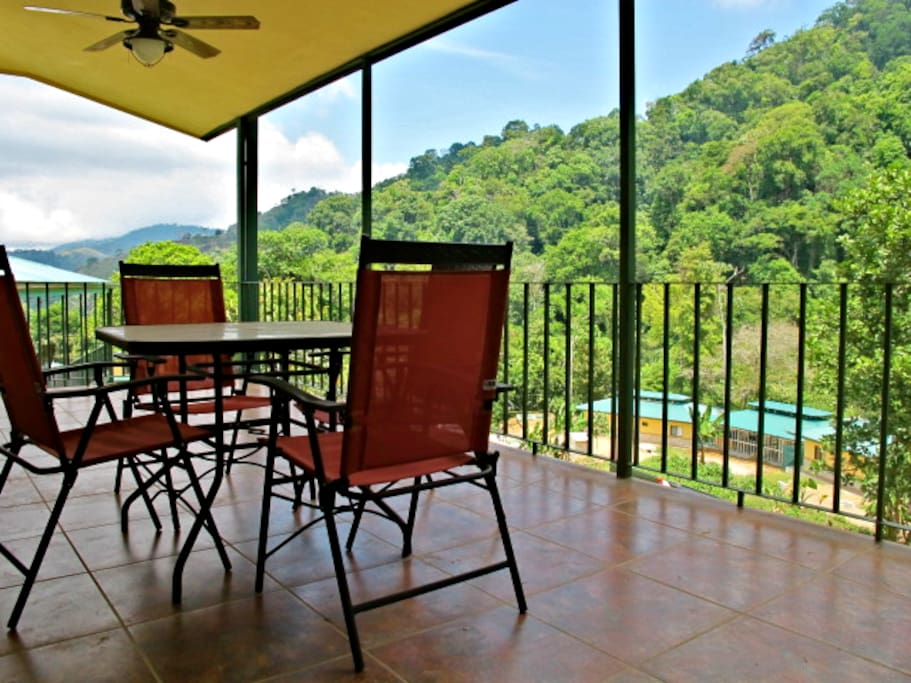 Expansive deck looking out toward the jungle mountain