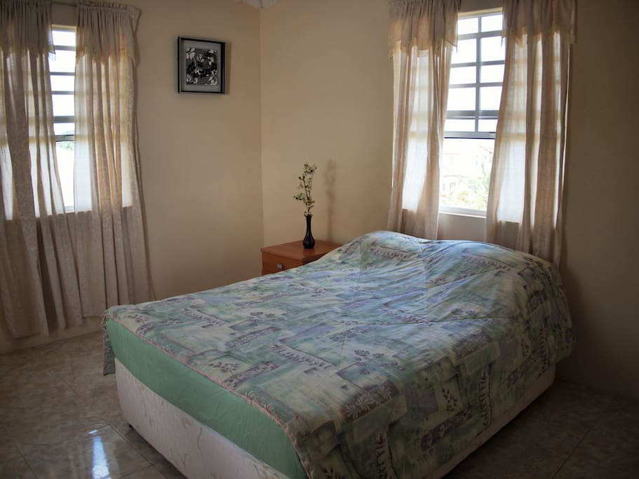 Breezy bedroom with 3 windows and fan