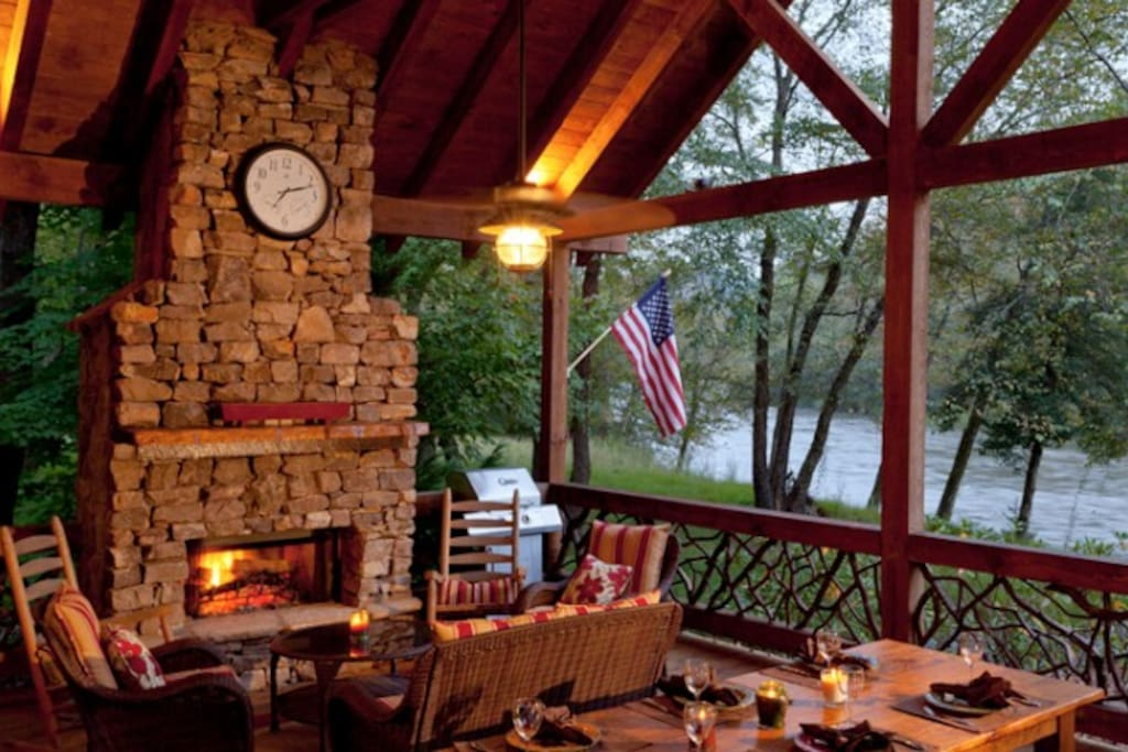 Dine Along the Toccoa River on the Covered Porch featuring a Stone Fireplace